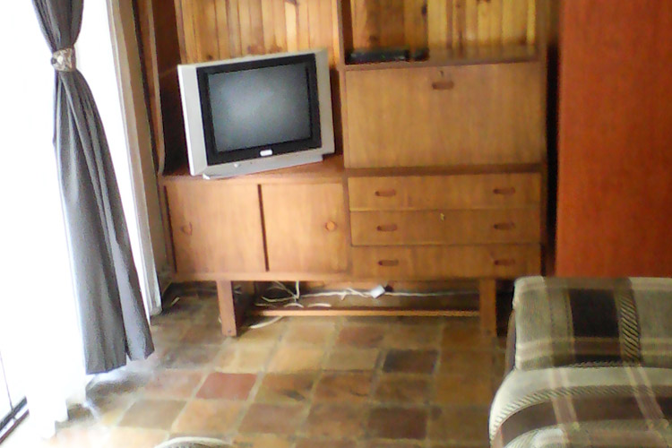 three-amigos-unit-1-tv-in-bedroom